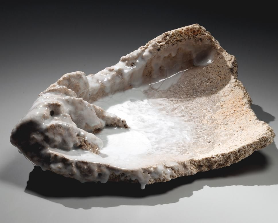 Torn, triangular sculpture with pooled and poured white translucent crackled glass 2014,