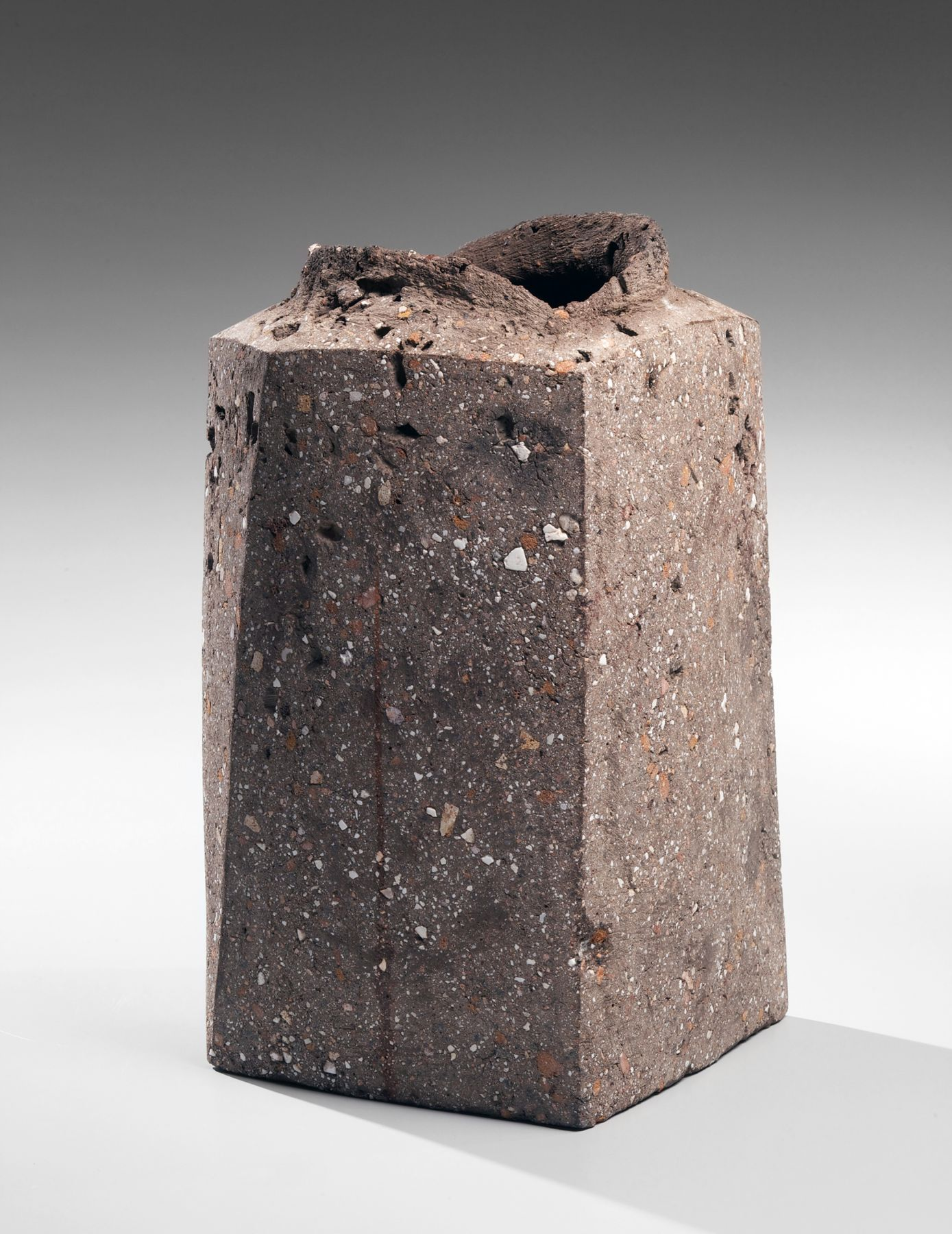 Itō Sekisui V (b. 1941), Standing four-sided rough grey vessel with raised torn mouth