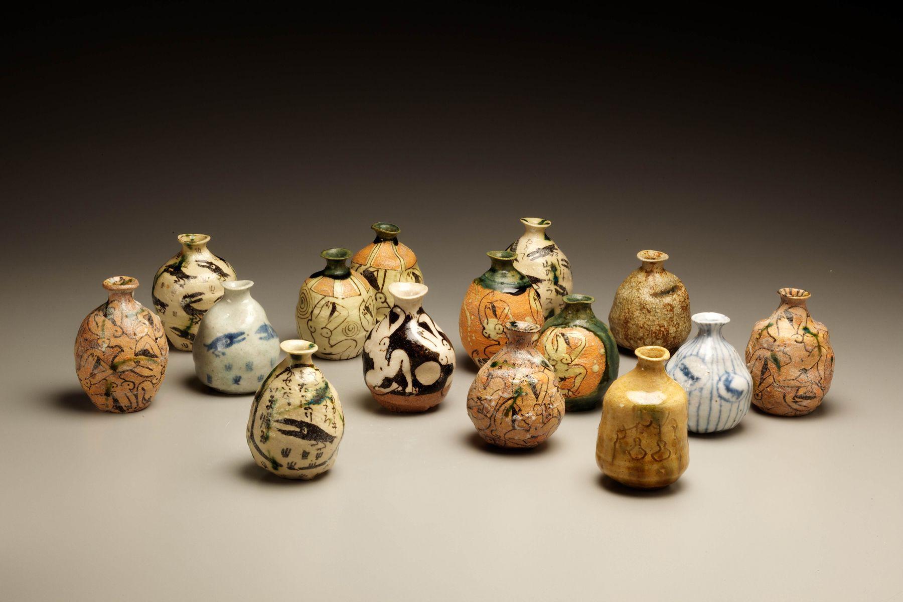 Set of 15 unique sake flasks in oribe glaze, ca. 1995