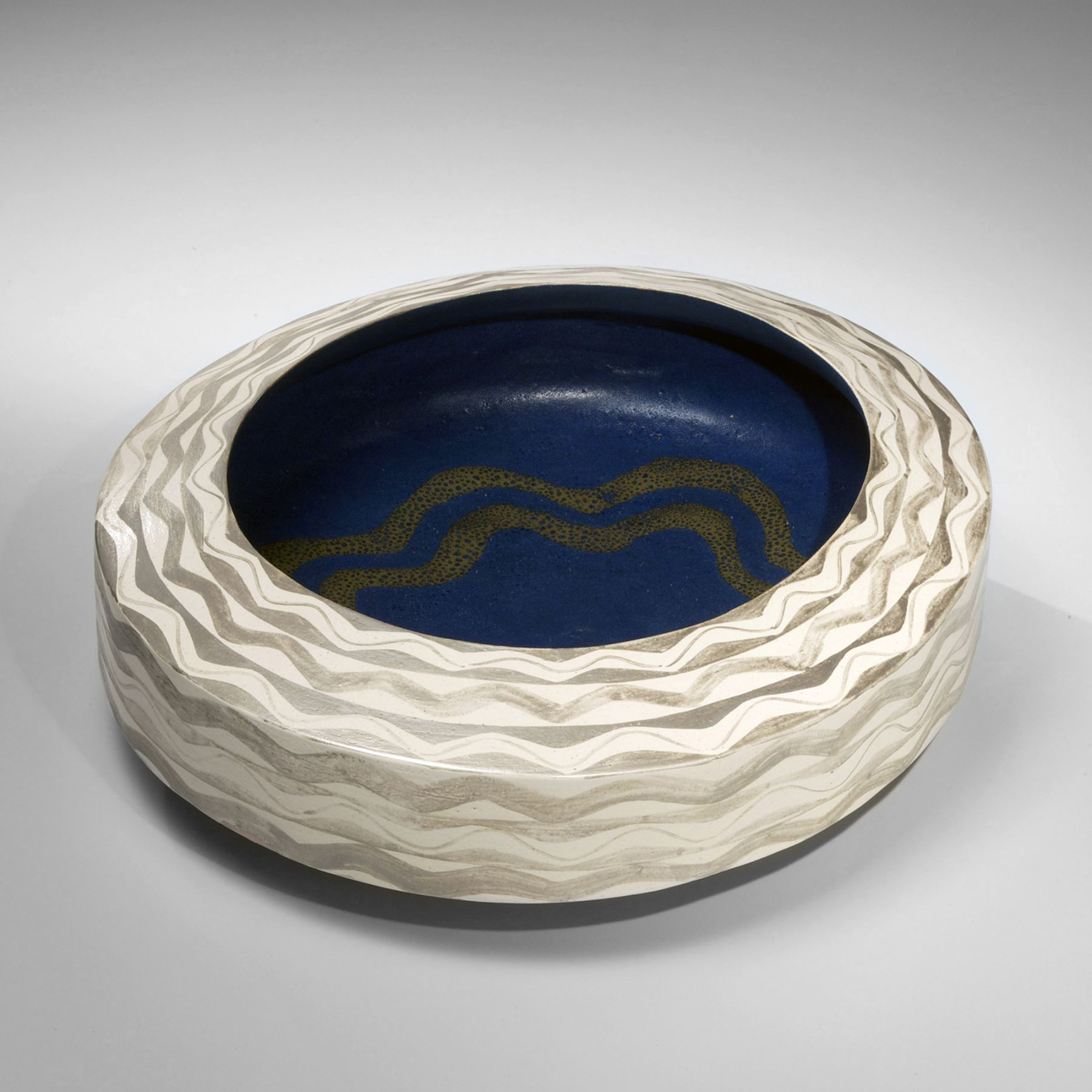 Morino Hiroaki Taimei (b.1934), Low, ovoid bowl with wave-patterned silver glaze and white, blue and gold glazed interior