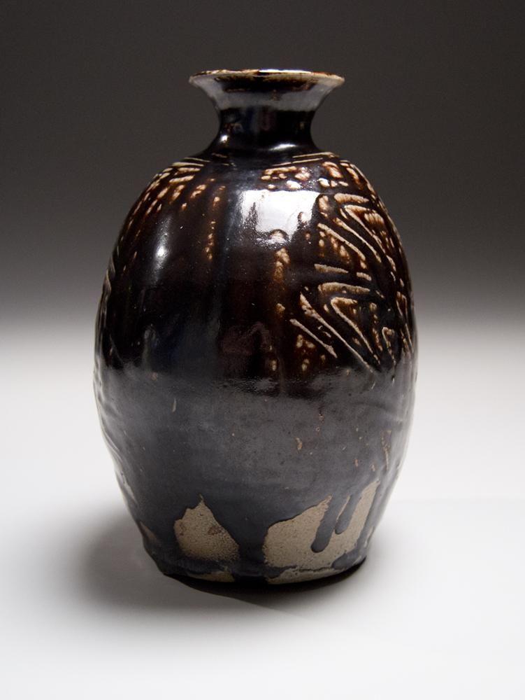 Hamada Shoji, Textured-surface, flattened vessel with dark brown shiogusuri (salt-glaze) and unraised mouth ca. 1955 Glazed stoneware, National Living Treasure Japanese contemporary clay, Japanese contemporary ceramics, Japanese modern ceramics,