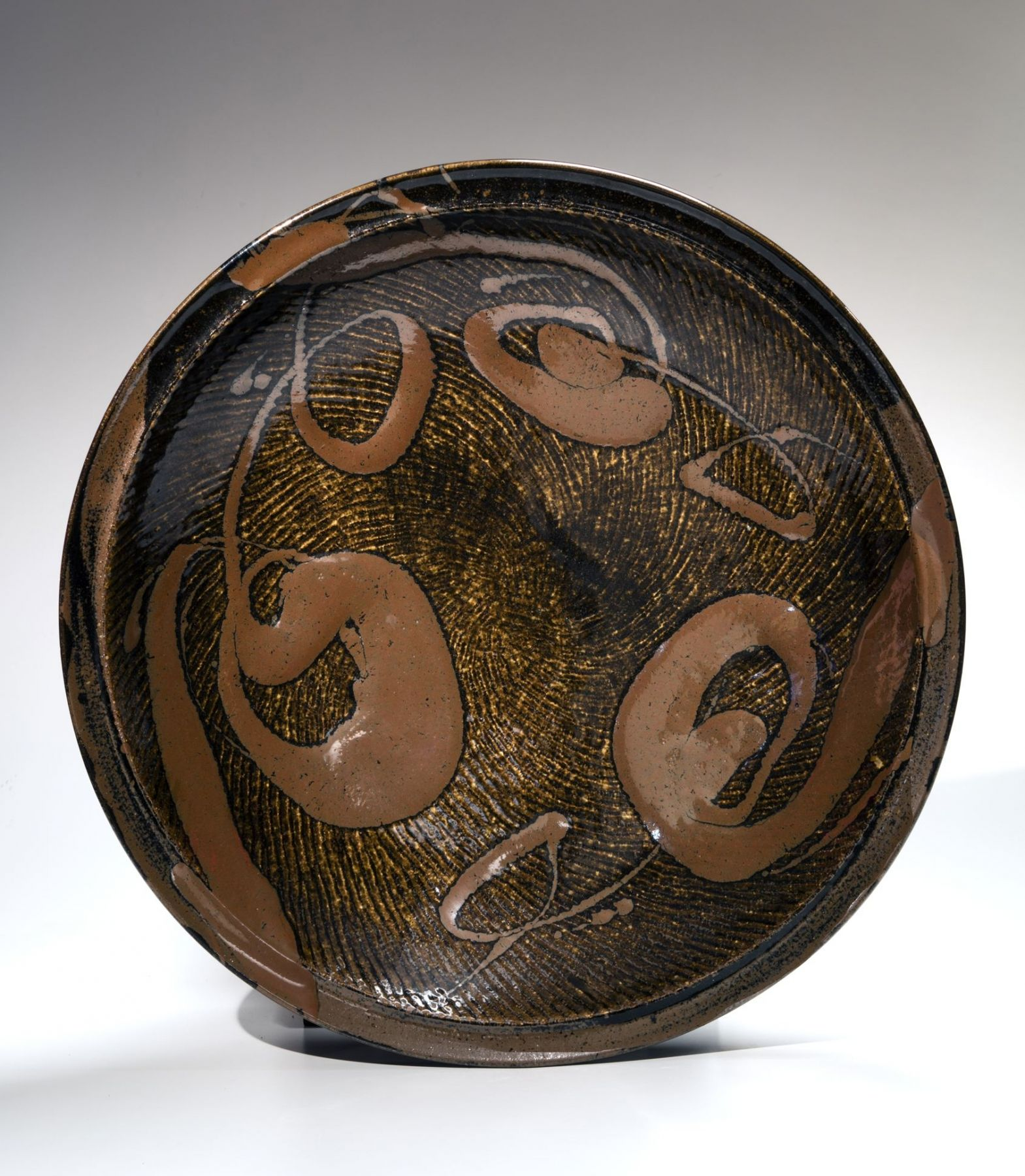 Black-glazed, rope-impressed large circular platter, ca. 1976