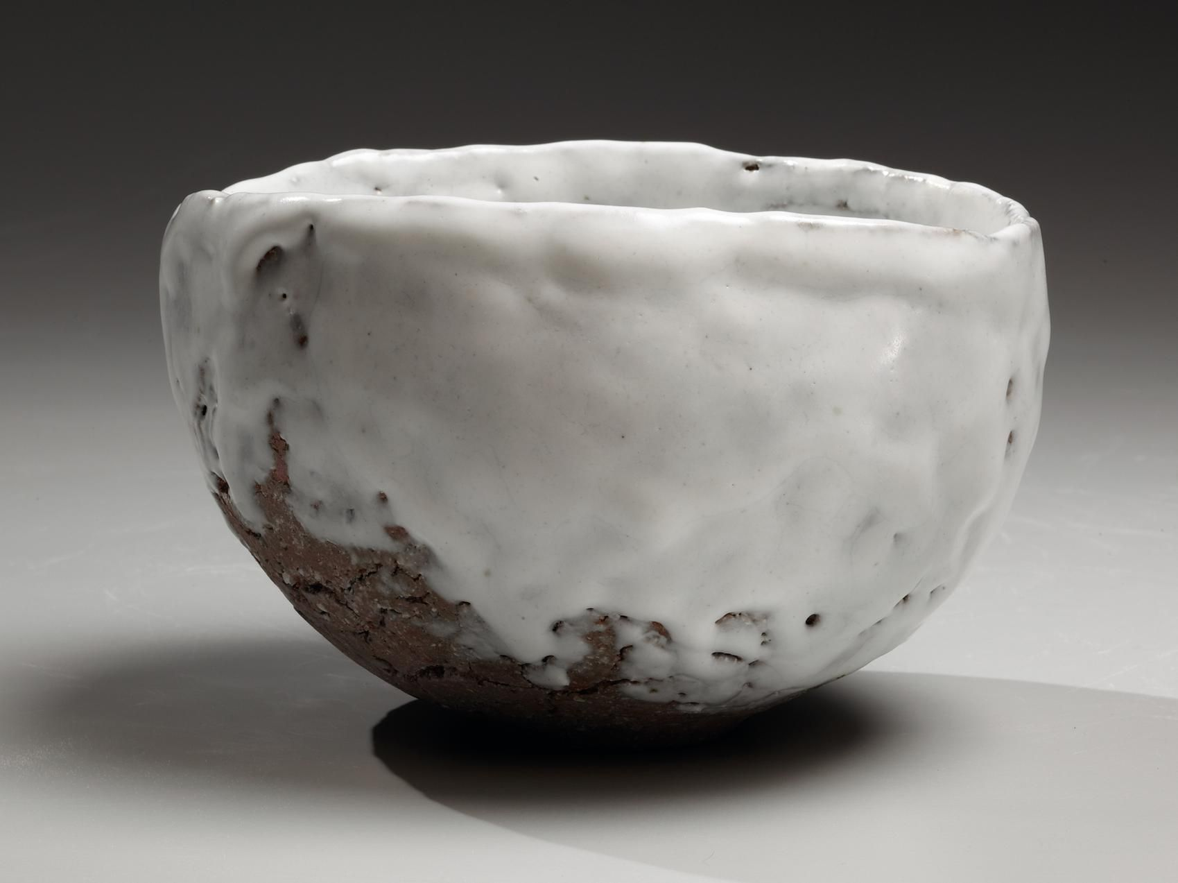 Round teabowl with unctuous white glaze over feldspar-infused crackled clay body, 2014
