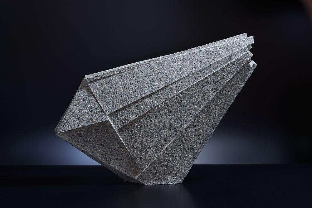 Large diagonal triangular sculpture with upsept end, 2012