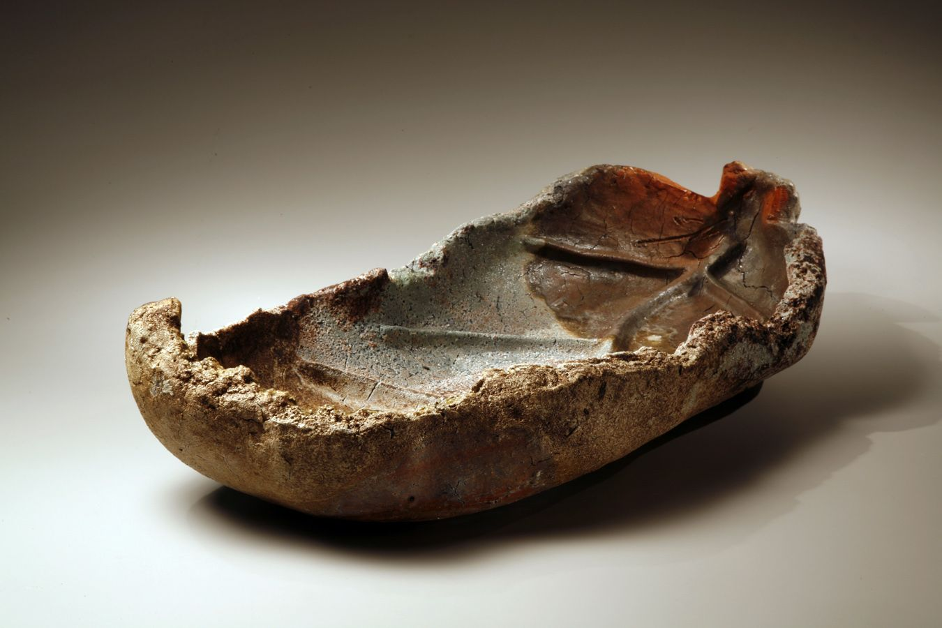 Large leaf-shaped Bizen-ware platter with curled edges and dynamically molded 'veins', 2006