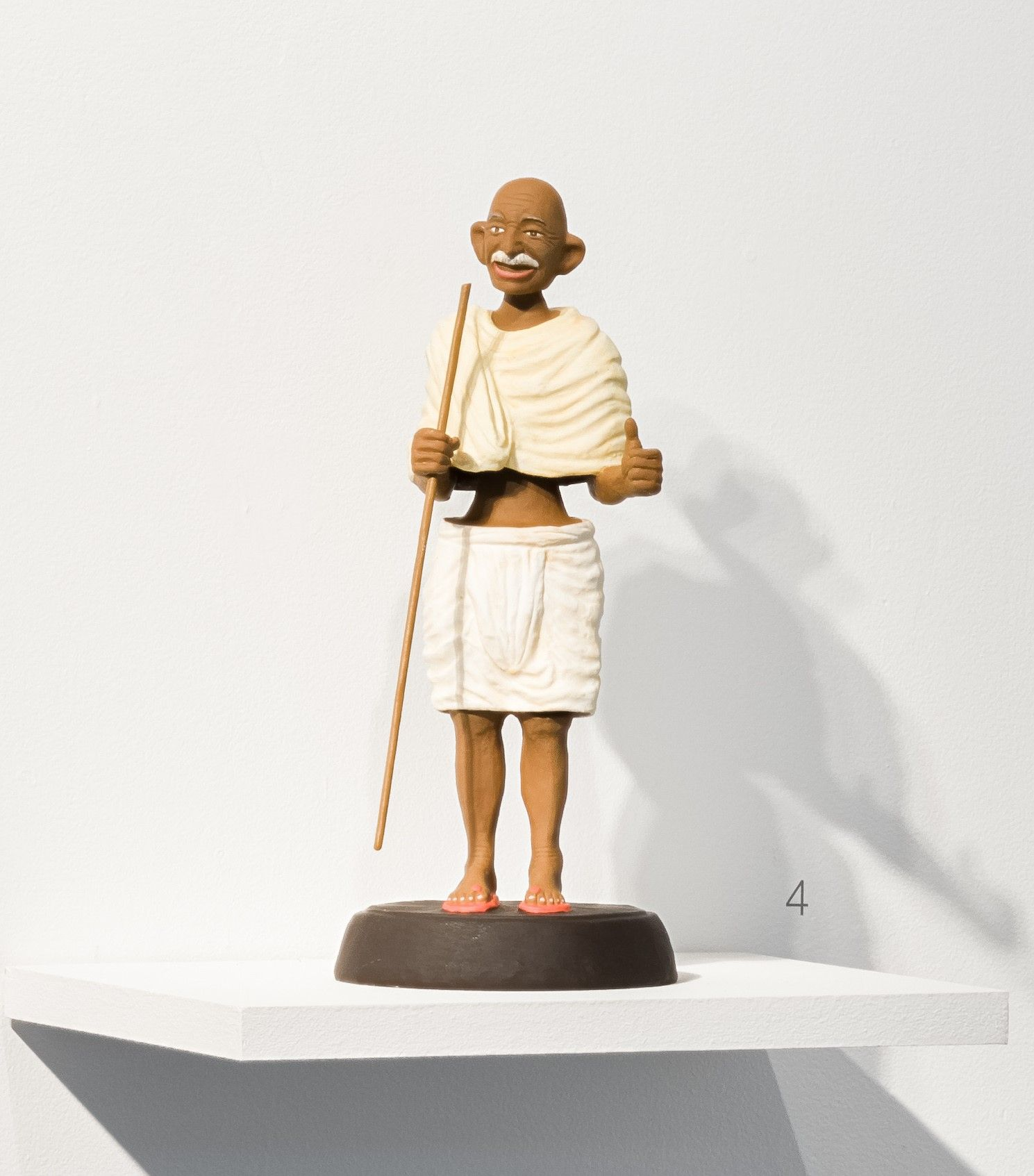 Debanjan Roy  Toy Gandhi 6 (Small Bobble Head)  2019  Clay, paper, cloth, and iron fibre  16 x 8 x 8 in.