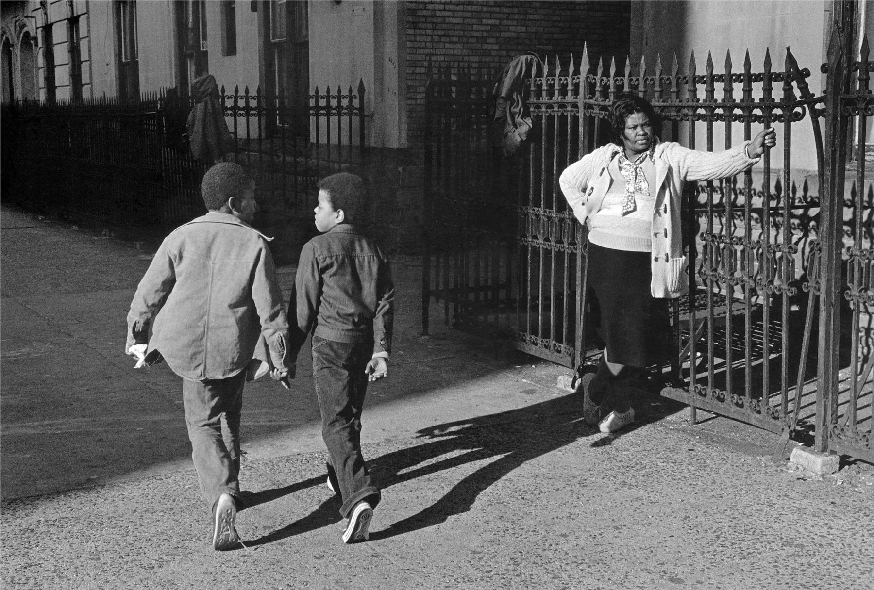 A Woman and Two Boys Passing, 1978