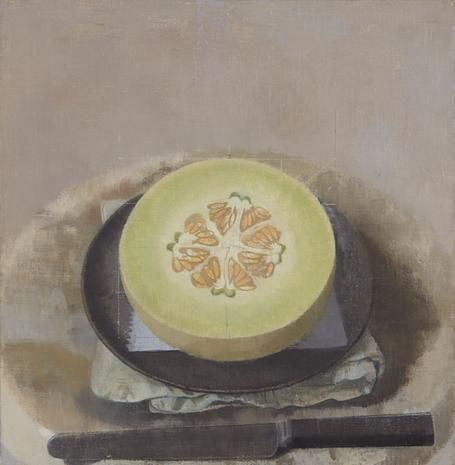 Melon Sliced Open on a Black Plate with Knife