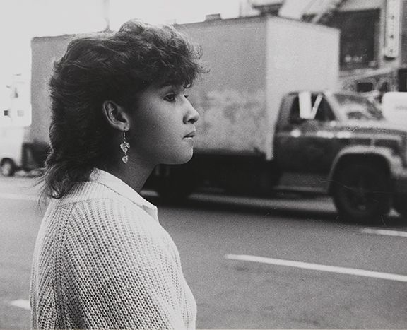 Rudy Burckhardt Untitled, New York (woman in white sweater, truck in background), c. 1985
