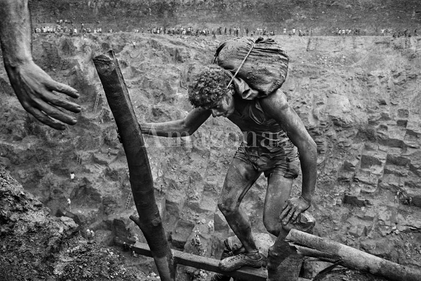 Sebastião Salgado, Gold mine of Serra Pelada, Pará, Brazil [carrier], 1986, gelatin silver print, 36 x 50 inches/91.44 x 127 cm. © Sebastião Salgado/Amazonas Images