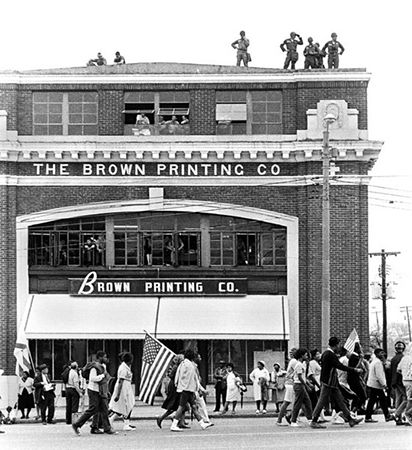 "Rooftop troops guarding marchers passing in front of ""The Brown Printing Company"", Selma to Montgomery, Alabama Civil Rights March, March 24-26, 1965"