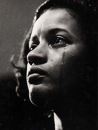 Myrlie Evers at her husband's memorial service, June 15, 1963