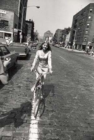 Woman Riding Bike on Brick Street, 11 x 14 Silver Gelatin Photograph