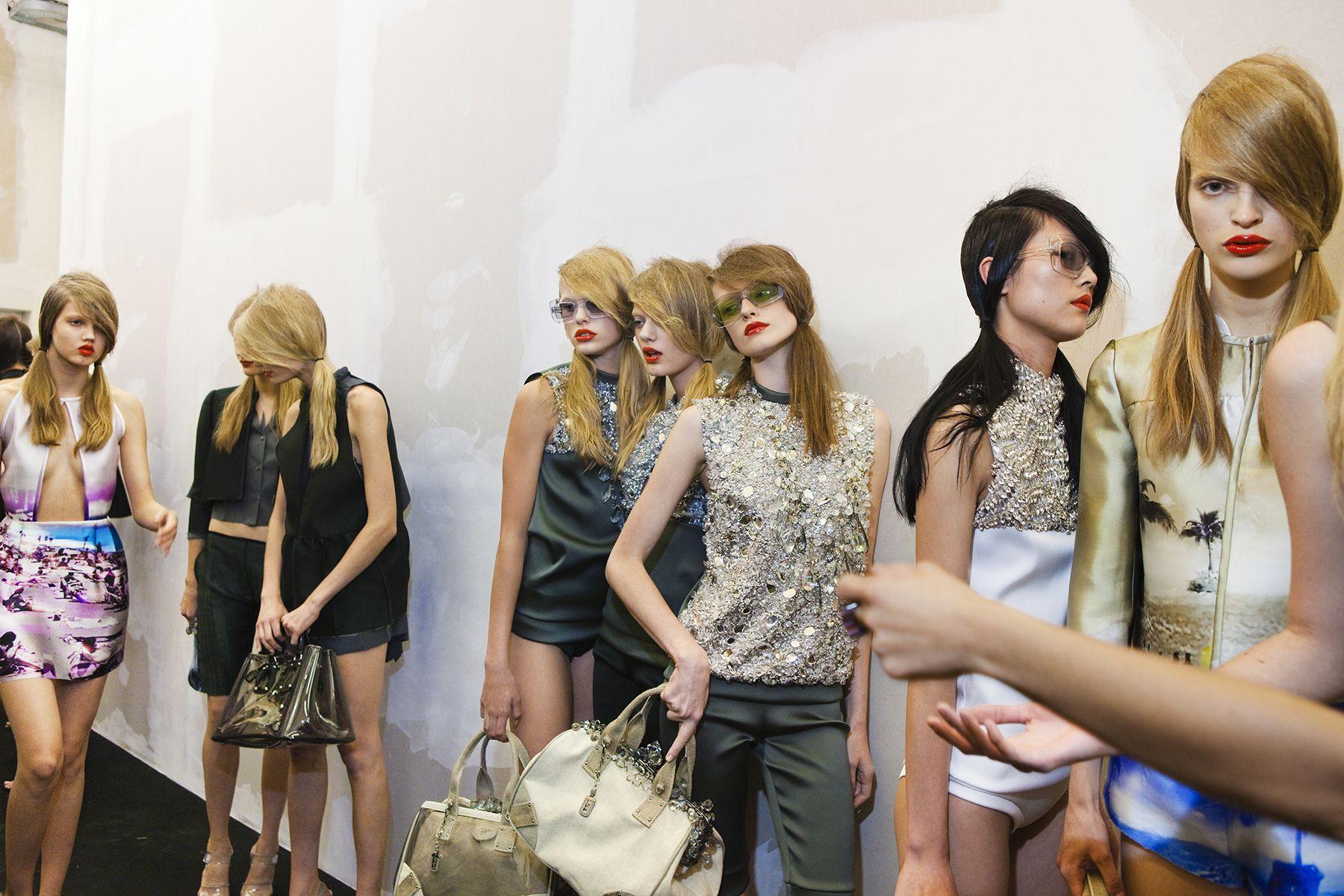 Models backstage at Prada's spring show, Milan, 2009