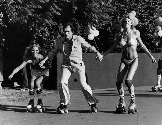 Hugh Hefner and two playmates on a Sunday afternoon party at The Mansion, Silver Gelatin Photograph