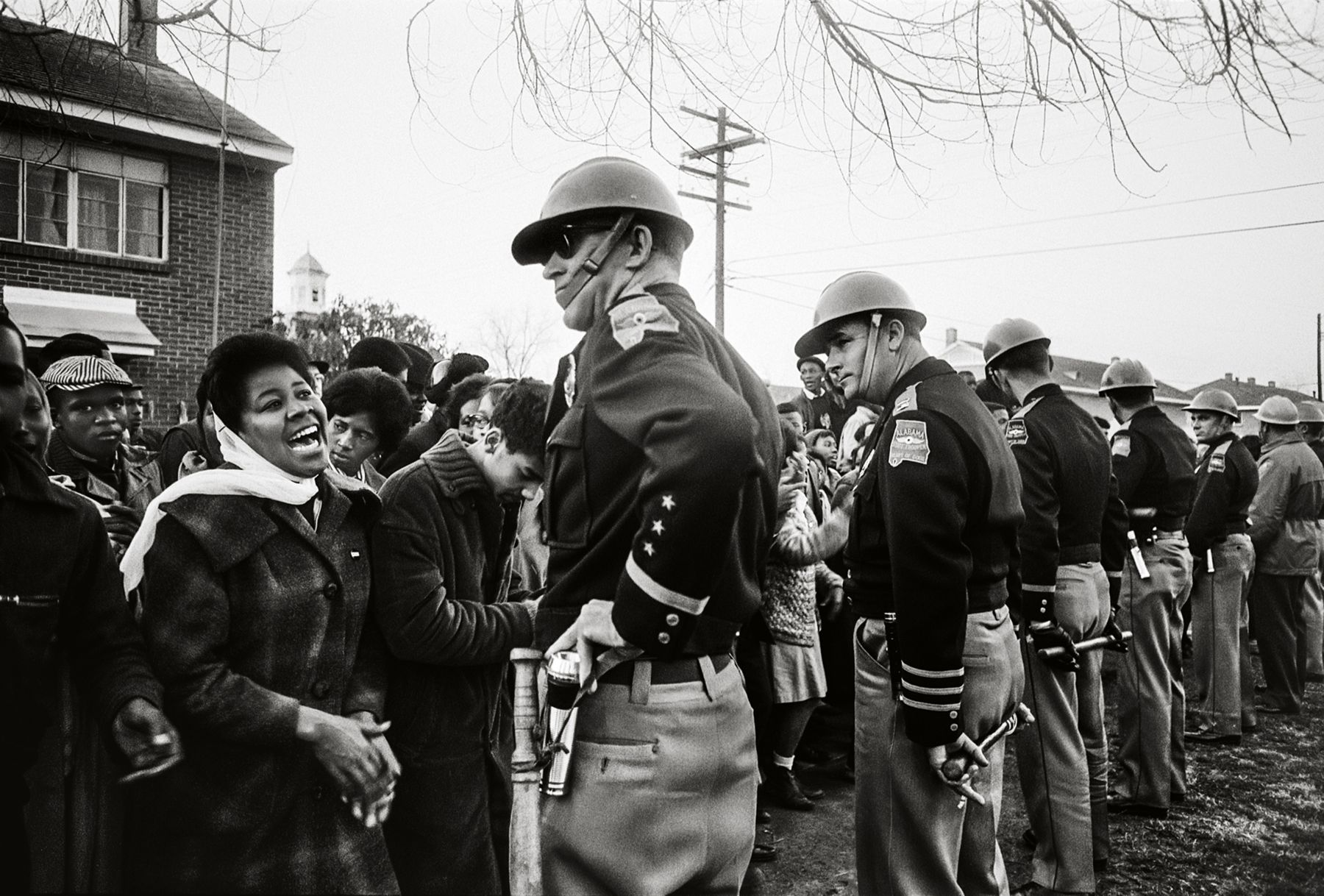 Demonstrator (Laughing) and Trooper, Philadelphia, Mississippi, 1964, 16 x 20 Inches, Silver Gelatin Photograph, Edition of 25