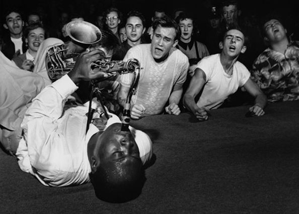 Big Jay McNeely, lying on the stage of the Los Angeles Olympic Auditorium, 1951