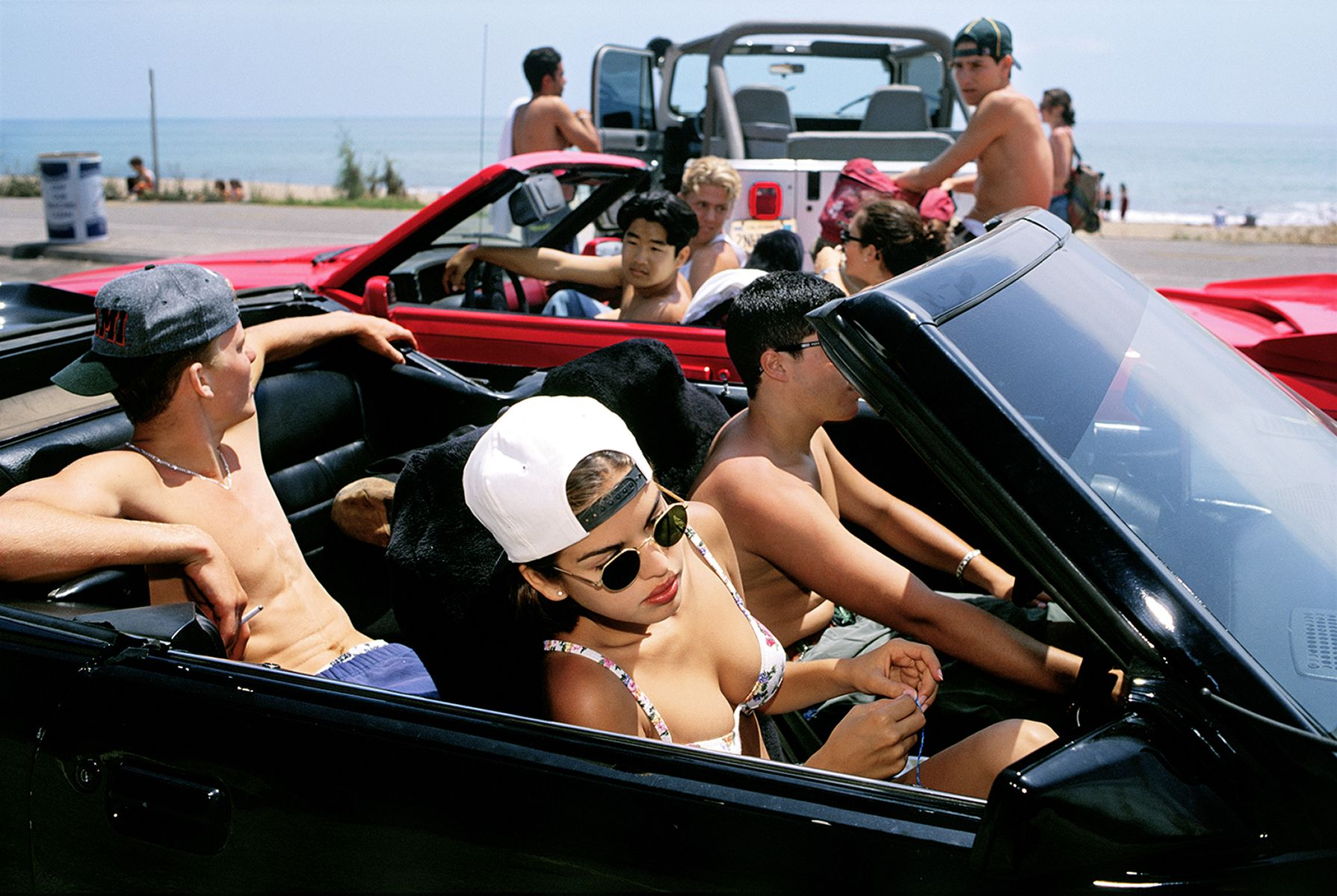 Mijanou, 18, who was voted Best Physique at Beverly Hills High School, skips class to go to the beach with friends on the annual Senior Beach Day, Santa Monica, California, 1993