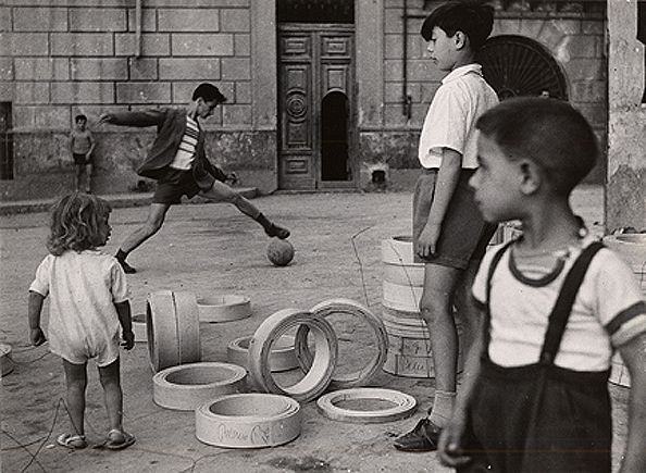Playing Soccer in the Streets, Naples, 1959, 8-7/10 x 11-1/2 Vintage Silver Gelatin Photograph