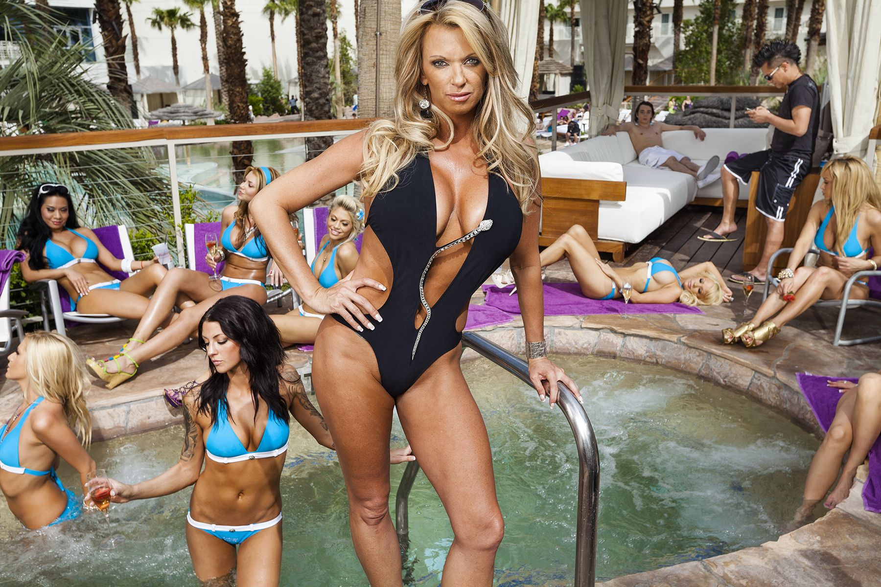 """VIP hostess Tiffany Masters, 38, with her Cabana Candy team at the Hard Rock Hotel and Casino, Las Vegas, 2010. Masters arranges access to Vegas nightclubs and attractions for her clients and employs young, attractive women she calls Arm Charms to provide them with """"rock star"""" treatment."""