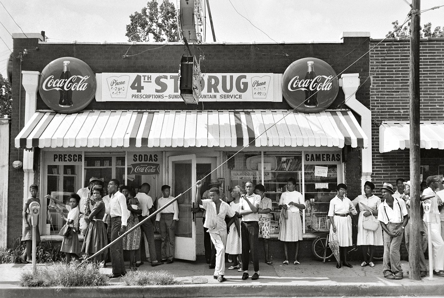 """Organizers at """"Doc"""" Aaron Henry's Drugstore, Clarksdale, 1963, 16 x 20 Inches, Silver Gelatin Photograph, Edition of 25"""