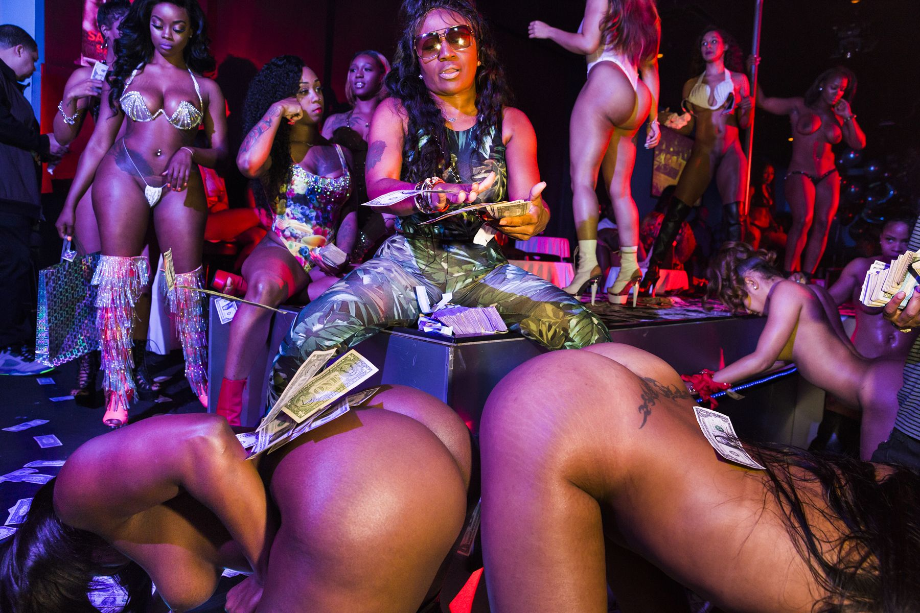 Former stripper OG India helps a rising rapper friend make it rain at Magic City Monday, the club's most important night for aspiring hip-hop stars to make an impression and encourage the strippers to request their music more often, Atlanta, 2015