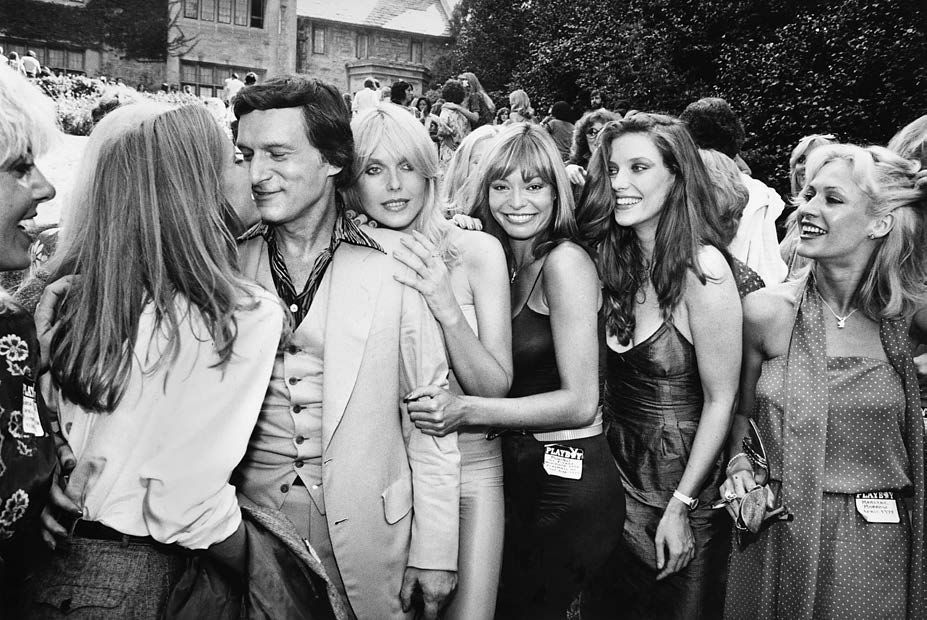 Hugh Hefner at the Playboy Mansion in Holmby Hills with Playmates of the Year, 2004, Silver Gelatin Photograph