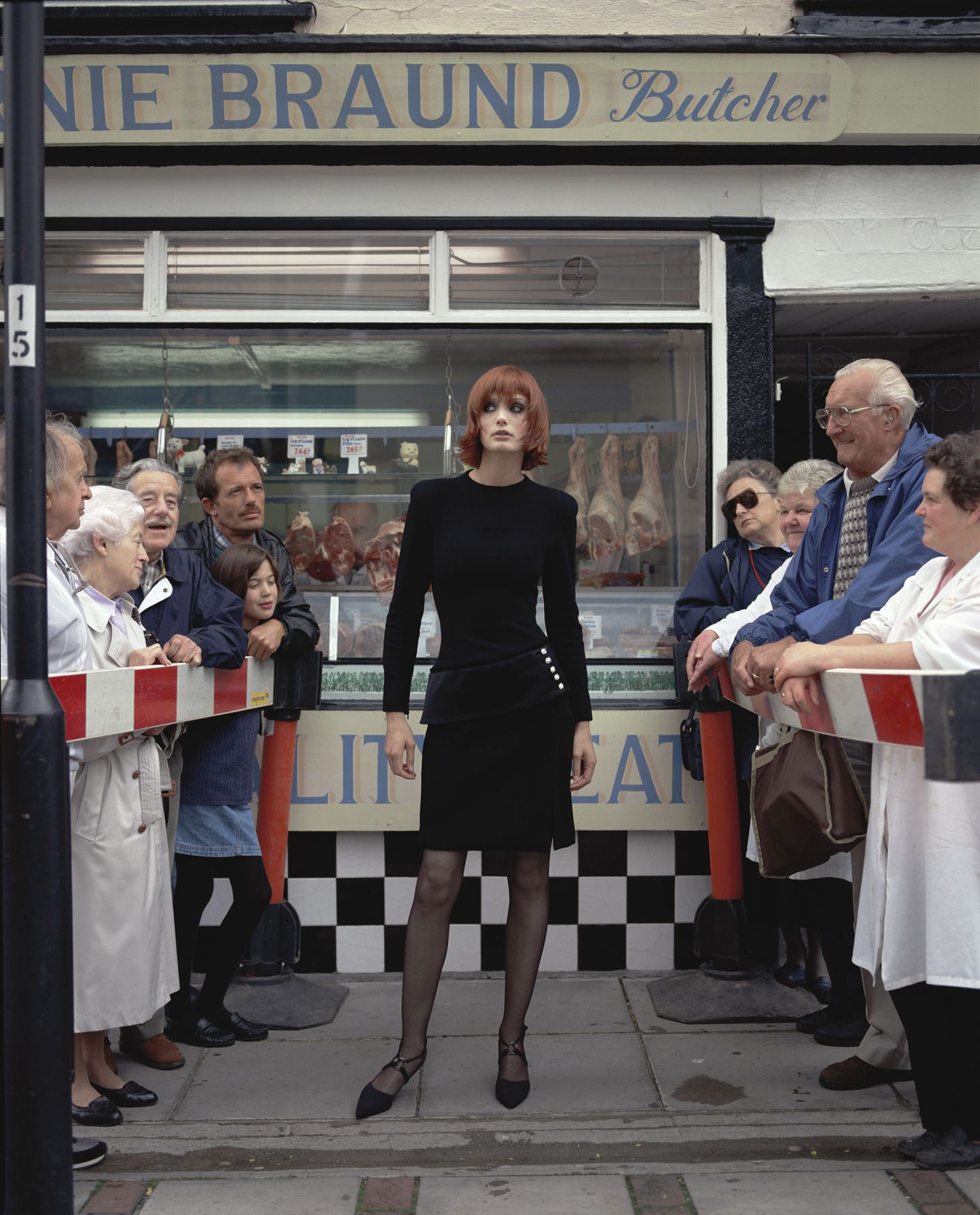 Model in Front of Butcher Shop, England, 1995, Archival Pigment Print