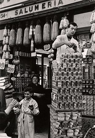 Stacking Tins on the Street, Naples, 1961, 11-3/8 x 7-13/16 Vintage Silver Gelatin Photograph