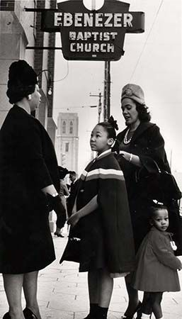 Coretta Scott King and her daughters, Yolanda and Bernice, talk with a fellow parishioner outside Ebenezer Baptist Church in Atlanta, 1963