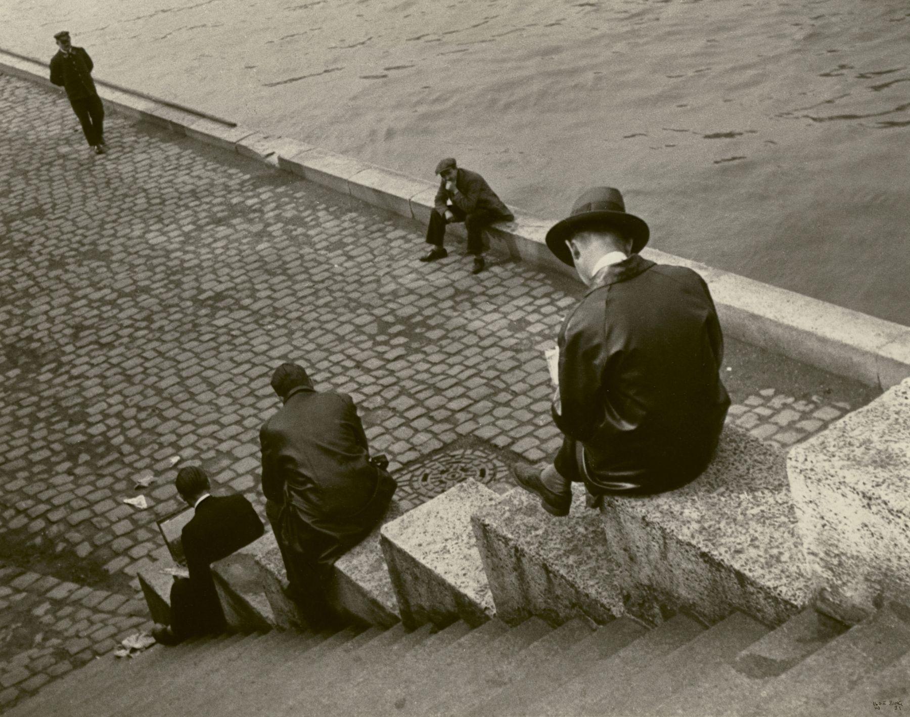 Ilse Bing Three Men Sitting on Steps at the Seine, Paris