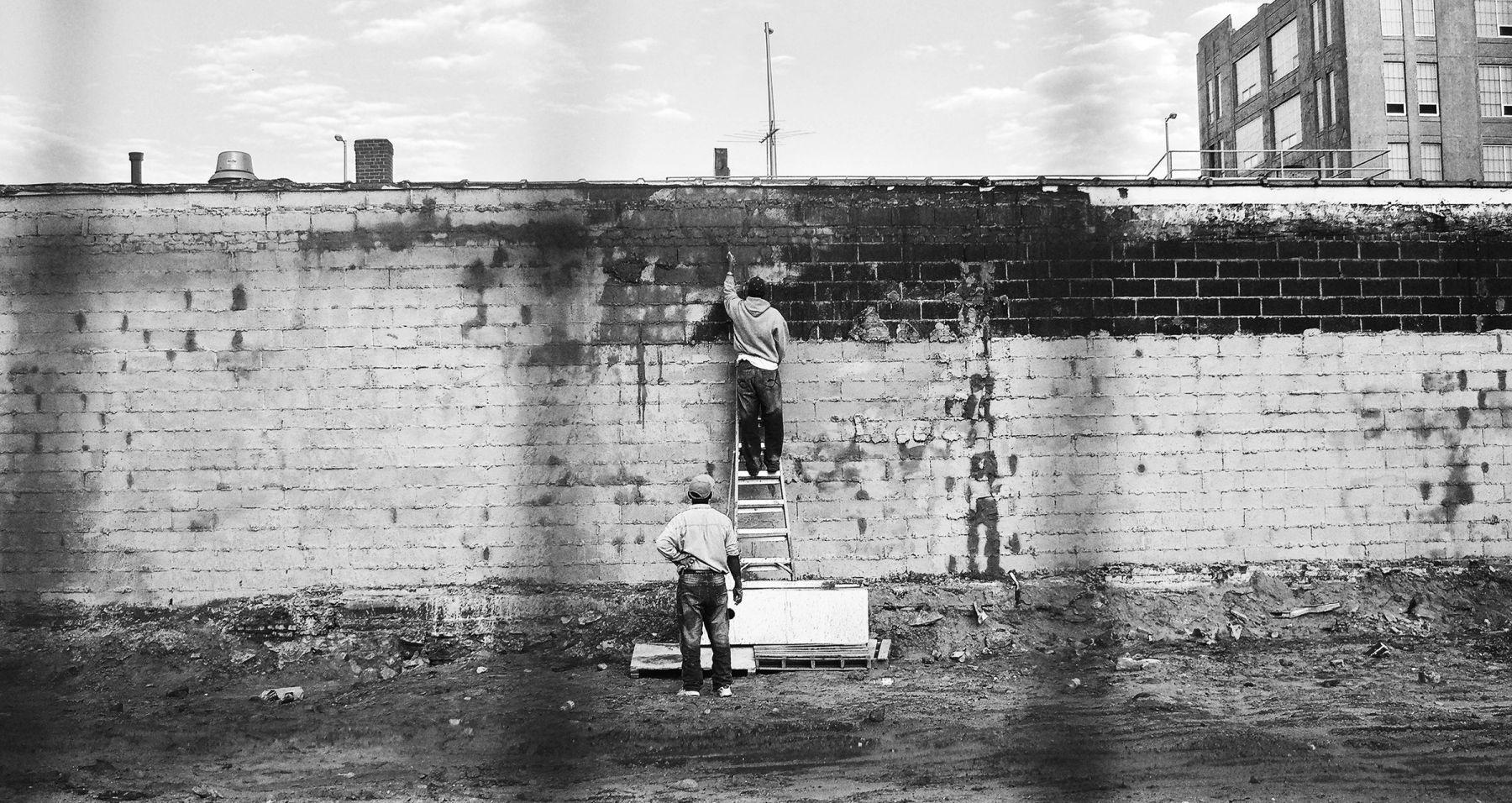 MONICA BONVICINI Untitled (two men building a wall)