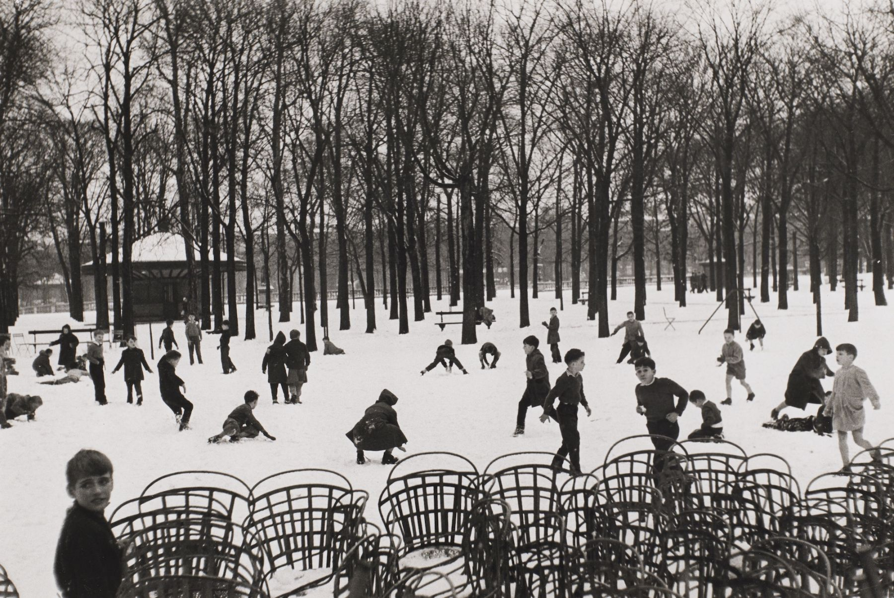 Edouard Boubat (1923-1999)  Enfants dans le Premiere Neige, 1953, printed later  Gelatin silver print  9 1/2h x 14 1/4w in, black and white photography