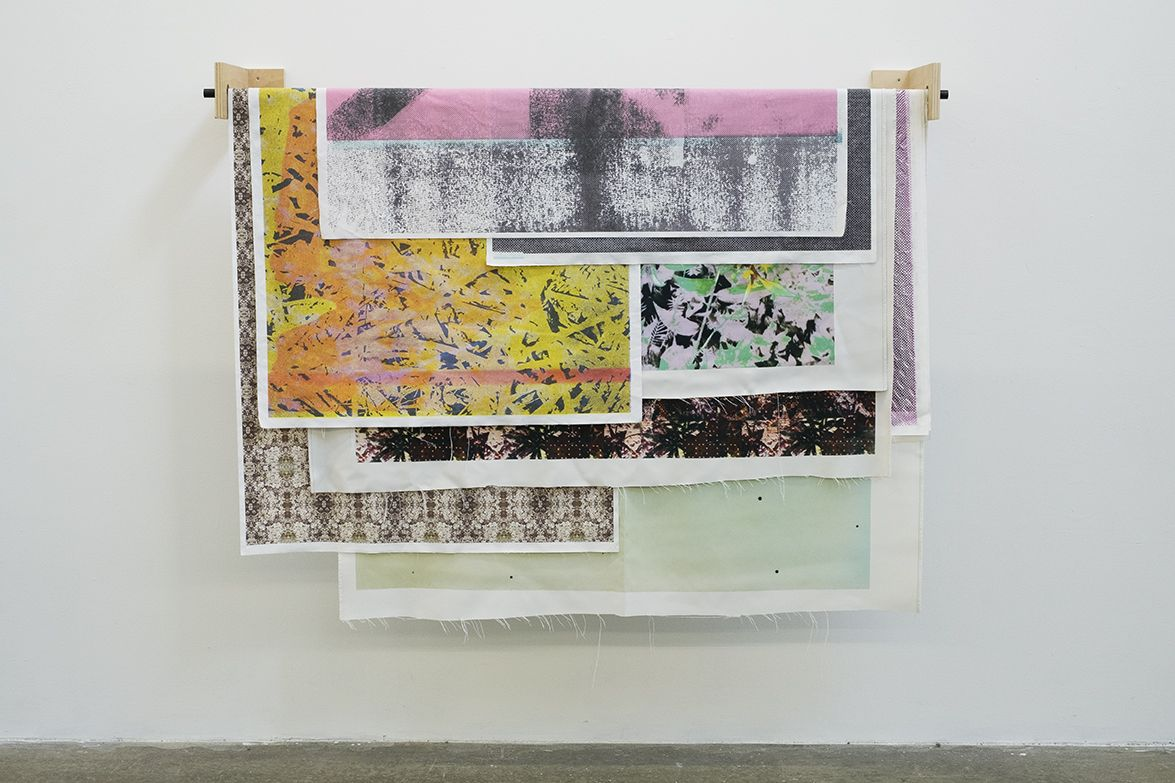Bryan Graf  Debris of the Days, 2018-ongoing  Modular installation, Inkjet prints on cotten linen fabric, dye sublimation prints, wooden brackets and steel roller bar  Dimensions variable