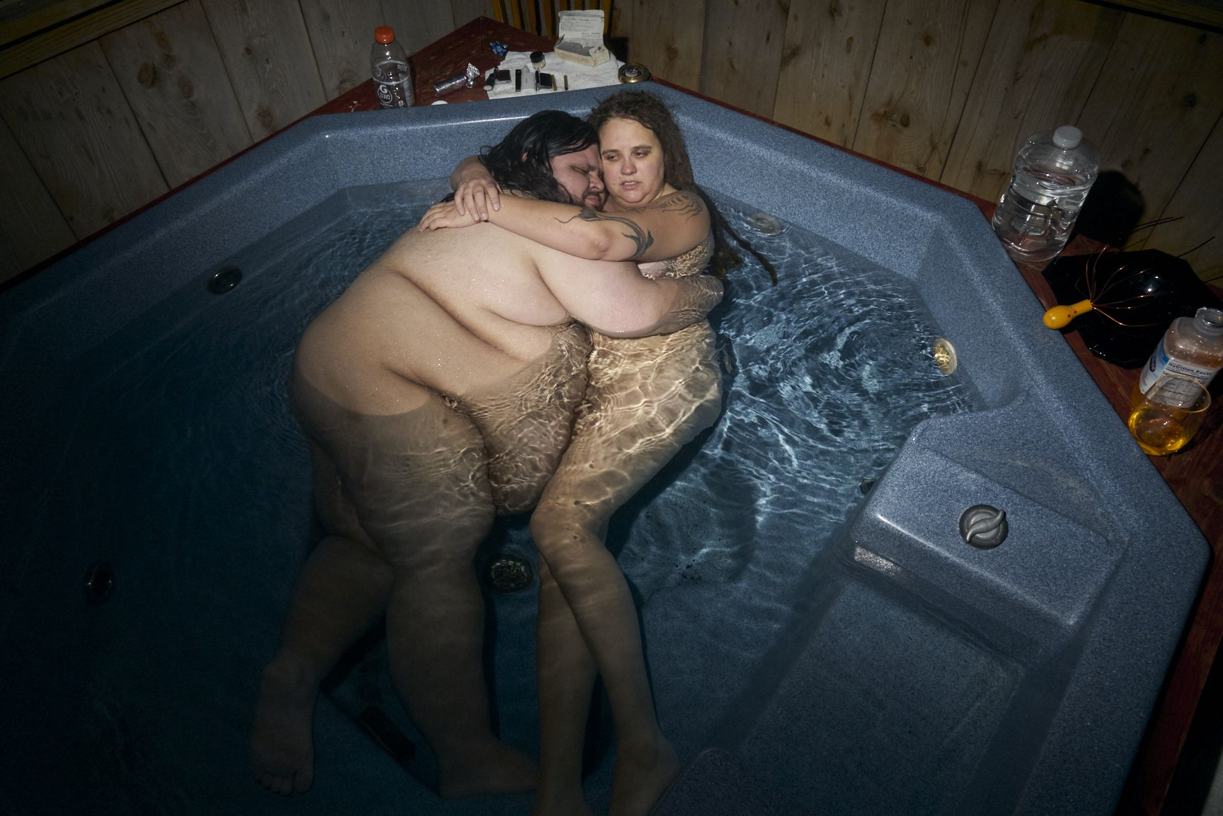Stacy Kranitz  Hot Spring, North Carolina, 2019  Archival Pigment Print  Archival Pigment Print  16 x 24 inches, Edition of 7  27 x 40 inches, Edition of 3, nude couple embracing in a hot tub, North Carolina
