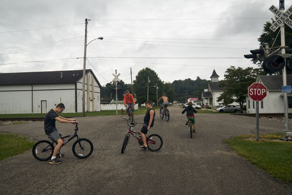 Stacy Kranitz  Mason, West Virginia, 2017  Archival Pigment Print, 16 x 24 inches, Edition of 7  20 x 30 inches, Edition of 3, Group of kids on bikes, WV