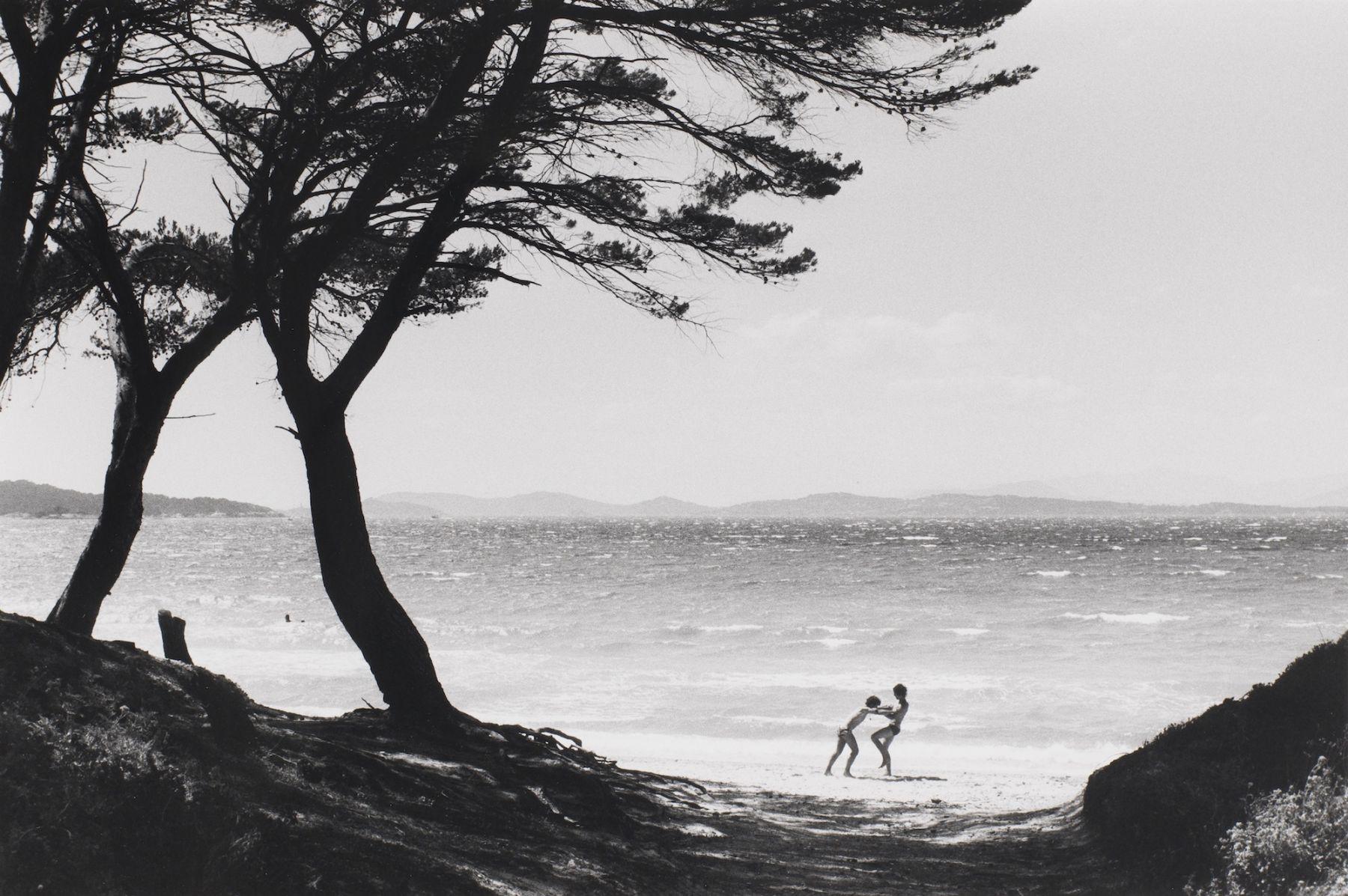 Bernard Plossu (1945-)  Untitled (Playing on beach, two trees), n.d.  Gelatin silver print  12 x 16 inches (paper), black and white photography black and white photography