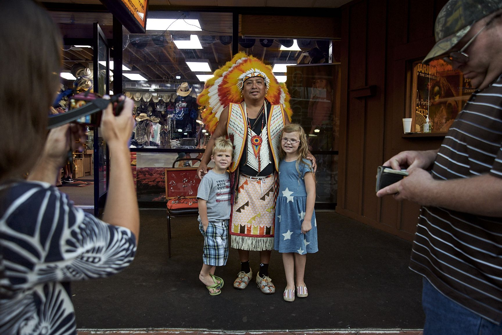Stacy Kranitz  Gatlinburg, Tennessee, 2016  Archival pigment print  16 x 24 inches, Edition of 7  27 x 40 inches, Edition of 3, Two children and a native american in traditional dress