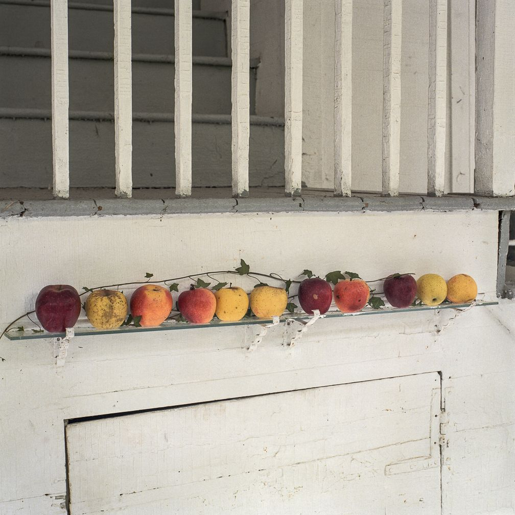 Ken Abbott, Apples grown at Hickory Nut Gap Farm, displayed on the porch of the Big House, the former Sherrill's Inn, in Fairview, NC, 2004, Archival Pigment Print on Cotton Rag Paper, 15h x 15w in, Edition of 15, Photography
