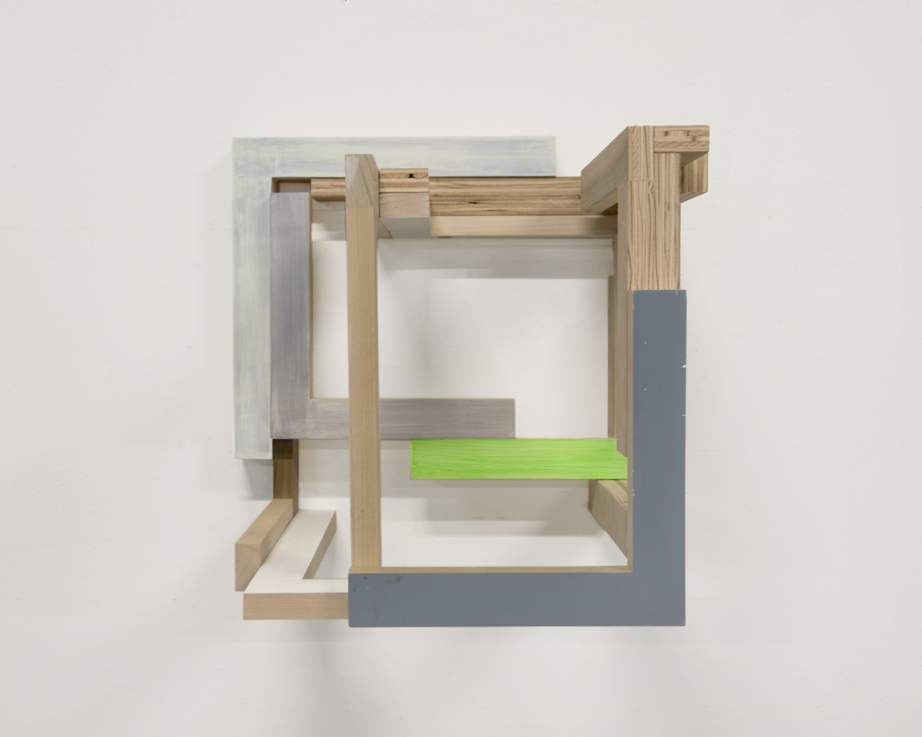 "James Woodfill ""Training Model: Wall Model #1"", birch plywood, poplar, maple with acrylic and gesso, wall mounted, 15"" x 15"" x 15"", 2019, an open wooden wall sculpture, with natural wood, light and medium grey, white and green"