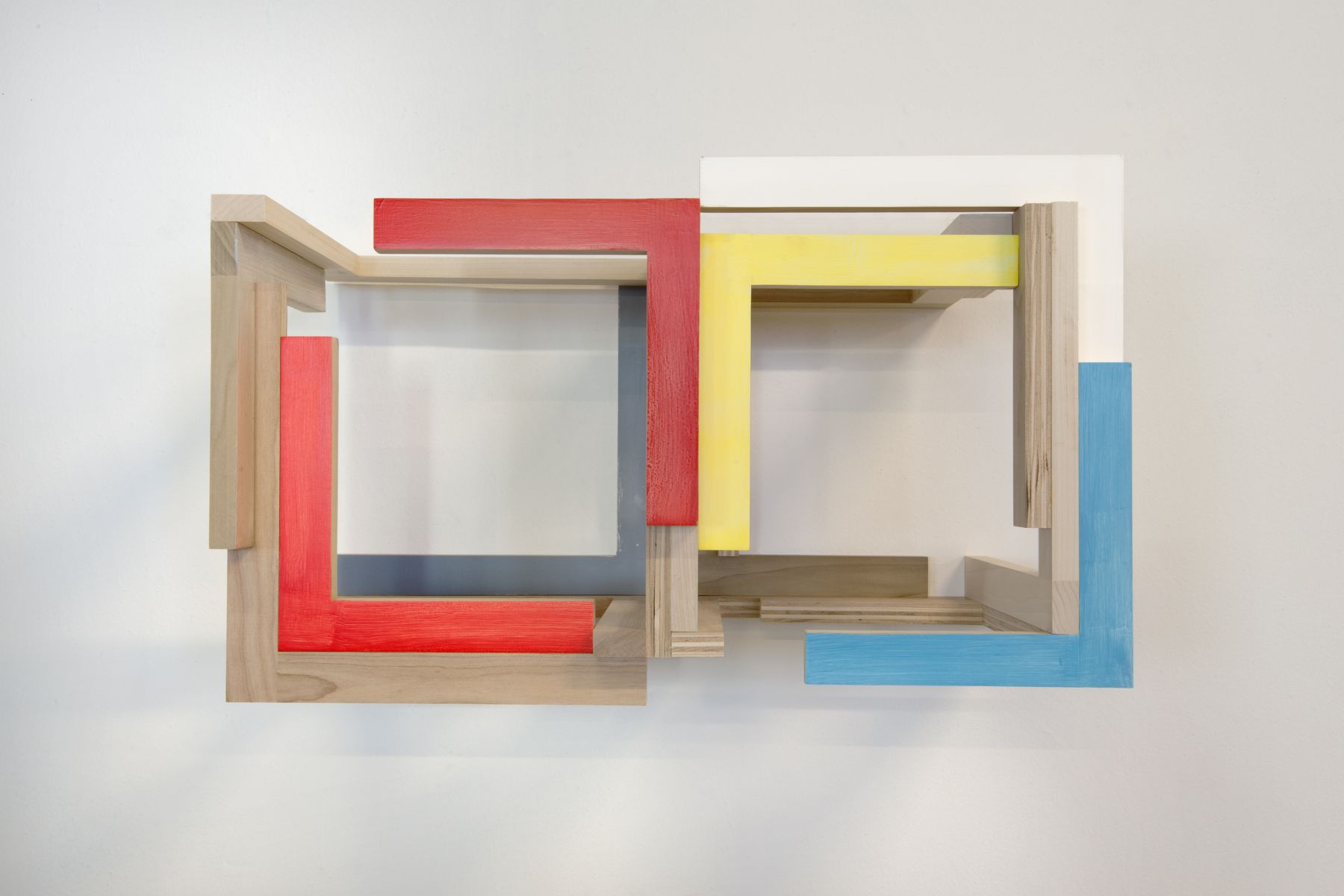 "James Woodfill ""Training Model: Wall Model #5 Deucea"", Birch plywood, poplar, maple with acrylic and gesso, wall mounted, 15"" x 27"" x 15"", 2019, an open double chambered wooden wall sculpture with natural, red, yellow, white, medium grey and blue"
