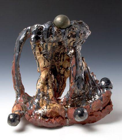 Pyrite Fourchette, 2007. Ceramic, bronze sphere, formica pedestal. Sculpture - 16 x 17.5 x 5 inches (40.6 x 44.5 x 12.7 cm); pedestal: 40 x 25 x 17 inches (101.6 x 63.5 x 43.2 cm). MP 38