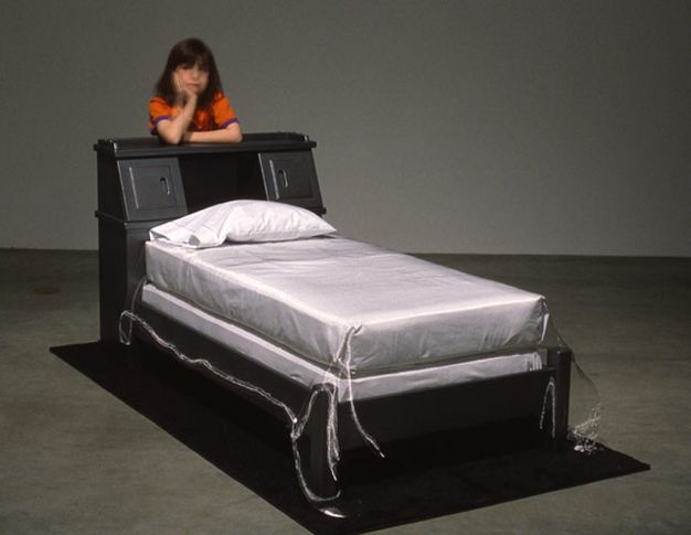 The bed Neil Armstrong slept in his first night back from the moon, 1969-1998. Wooden headboard and bed frame, mattress, box springs, pillow, pillow case,