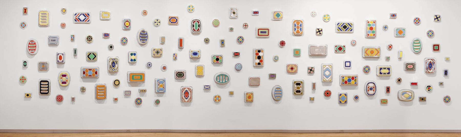 Wide view of B. Wurtz Pan Paintings installed at Aldrich Contemporary Art Museum