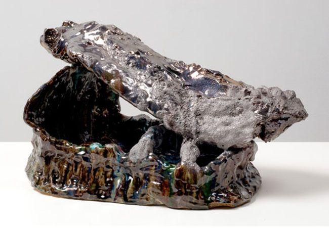 Head Artist / Archaeology 1, 2007. Ceramic, formica pedestal, sculpture: 12 x 13-1/2 inches (30.5 x 31.8 cm); pedestal: 48 x 26 x 22 inches (121.9 x 66 x 55.9 cm). MP 35