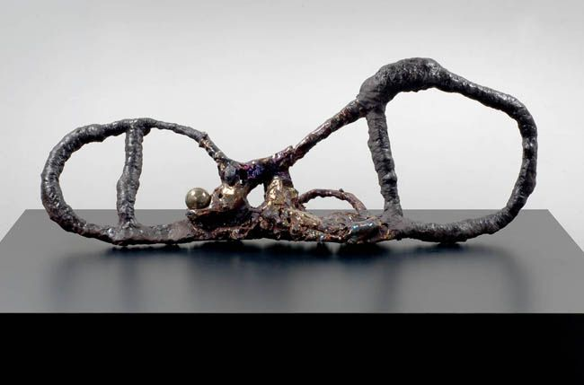 Figure Maker with Sphere, 2007. Ceramic, formica pedestal, sculpture: 18 x 46 inches (45.7 x 116.8 cm); pedestal: 24 x 40 x 64 inches (61 x 101.6 x 162.6 cm). MP 29