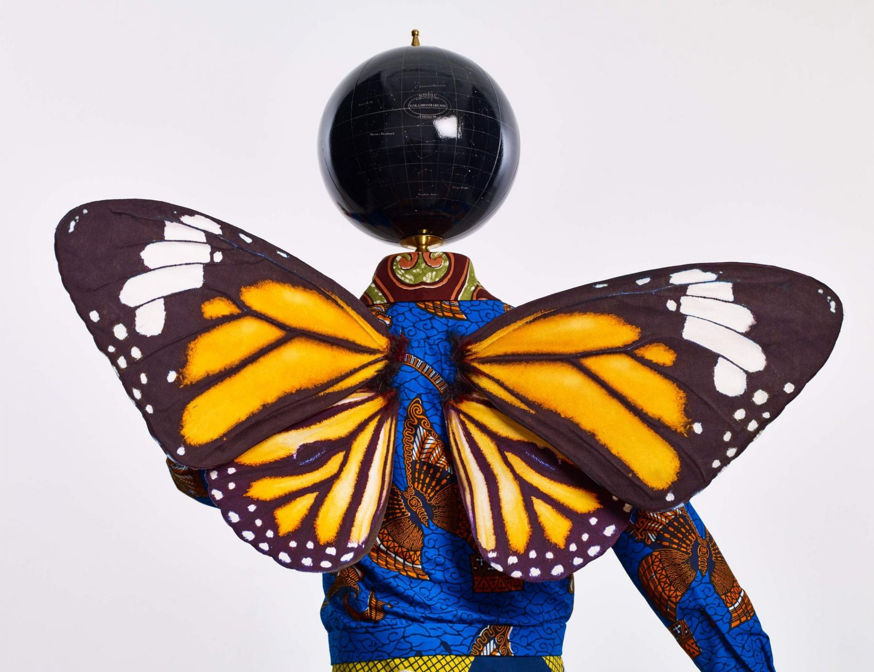 , YINKA SHONIBARE, MBE Butterfly Kid (boy) (detail), 2015 Fiberglass mannequin, Dutch wax printed cotton textile, silk, metal, globe, leather and steel baseplate 50 x 29 1/2 x 34 5/8 in. (127 x 75 x 88 cm)