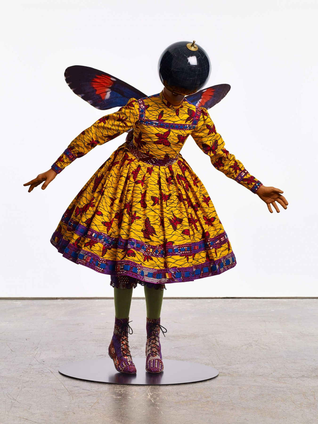 , YINKA SHONIBARE, MBE Butterfly Kid (girl), 2015 Fiberglass mannequin, Dutch wax printed cotton textile, silk, metal, globe and steel baseplate 49 3/16 x 41 5/16 x 29 7/8 in. (125 x 105 x 76 cm)
