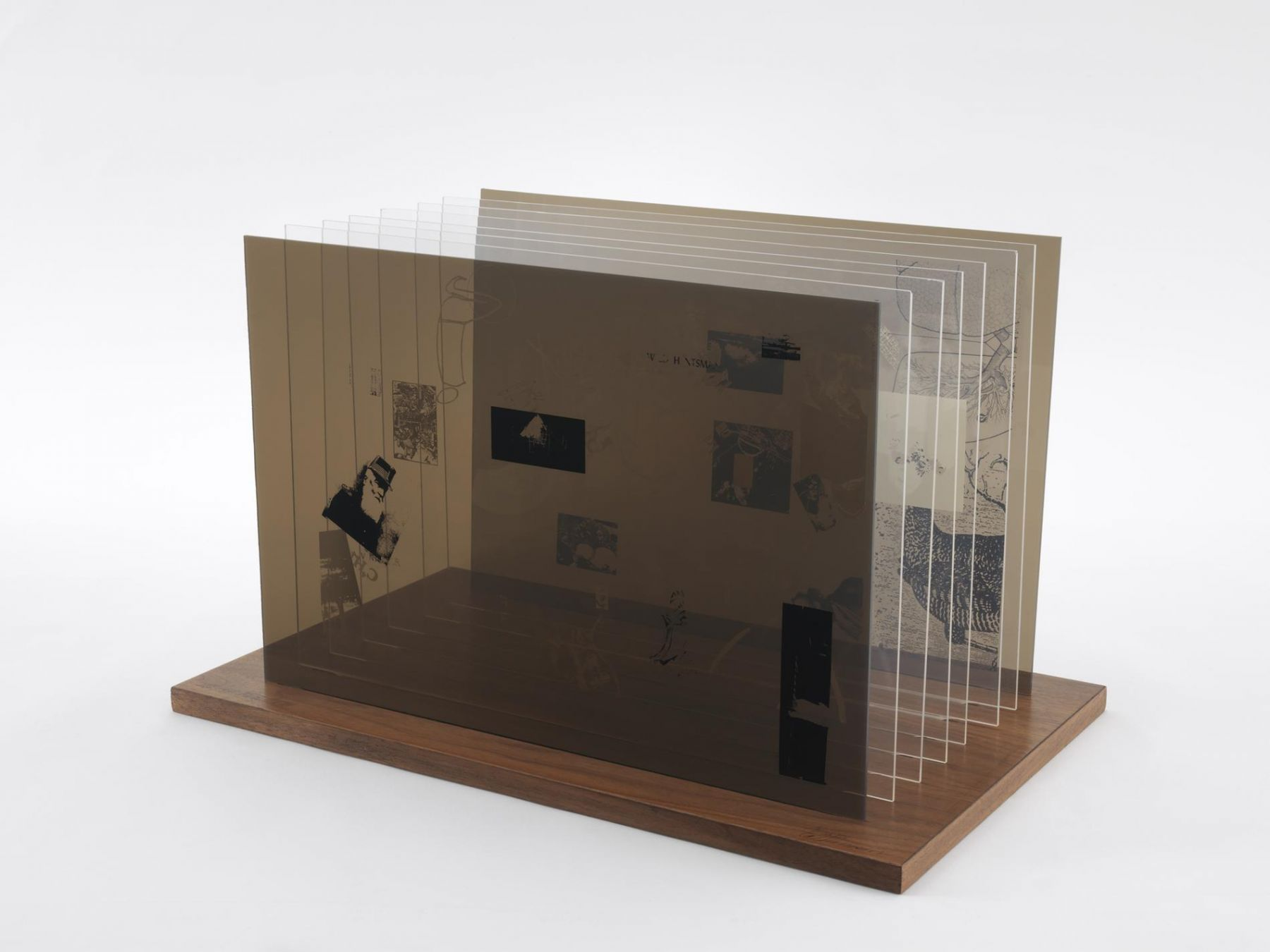 , JOHN CAGENot Wanting to Say Anything About Marcel Plexigram VII,1969Screenprint on eight Plexiglas panels with walnut base14 x 20 x 1/8 in. (35.6 x 50.8 x 0.3 cm)