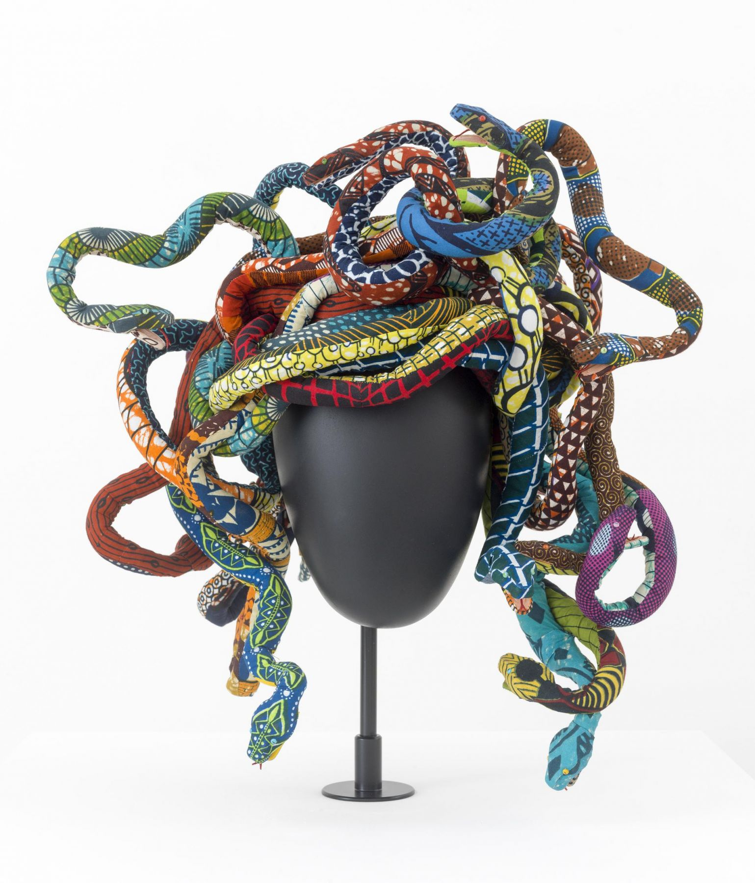 , YINKA SHONIBARE, MBE Medusa Head, 2015 Fibreglass head form, Dutch wax printed cotton textile, metal armature, and steel head stand 13 3/4 x 19 5/8 x 19 5/8 in. (35 x 50 x 50 cm)